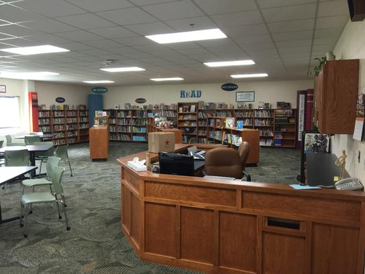 Librarian desk at entrance and book shelves in background